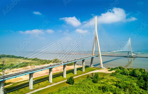 Fototapeta The Pont de Normandie, a road bridge across the Seine linking Le Havre to Honfle