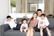 Parents Child Family father mother daughter son sit on sofa love affection happy