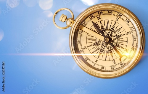 Fototapety, obrazy: Brass antique compass on wooden background