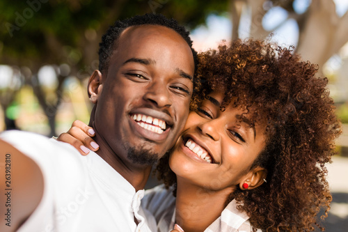 Outdoor protrait of black african american couple  taking a selfie Canvas