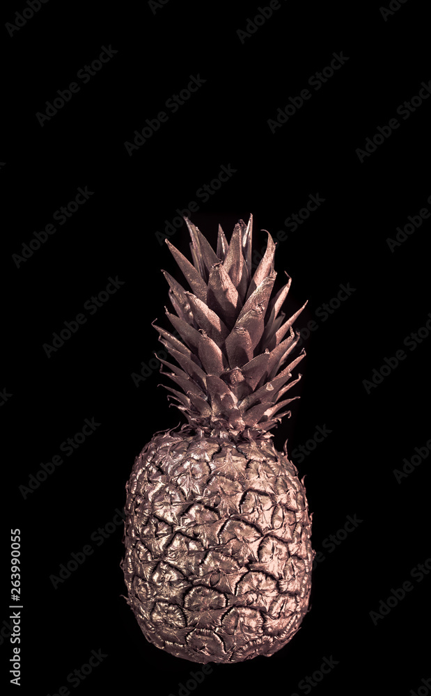 Golden pineapple on black isolated background creative and art