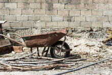 Old Wheelbarrow In The Garden