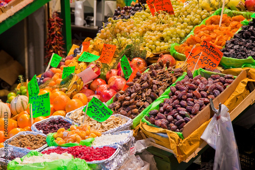Colored dried fruit in an italian market with dates in the foreground
