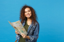 Young African American Girl Teen Student In Denim Clothes, Backpack Hold Map Isolated On Blue Wall Background Studio Portrait. Education In High School University College Concept. Mock Up Copy Space.