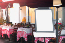 Italian Restaurant With Blank Menu Board On A Stand