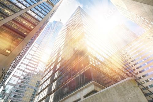Fototapety, obrazy: Modern office glass buildings over sky background