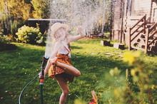 Happy Child Girl Watering Flow...