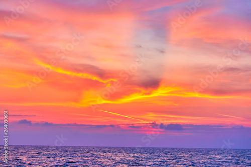 Foto auf Gartenposter Koralle sunset over sea