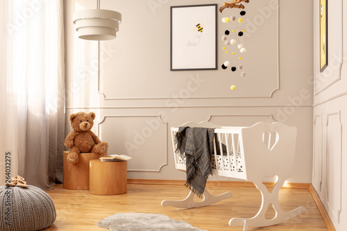 Fototapety, obrazy: Teddy bear on wooden stool in fashionable nursery with white wooden cradle with grey blanket
