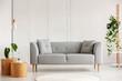 Leinwanddruck Bild - Grey modern sofa in the center of living room