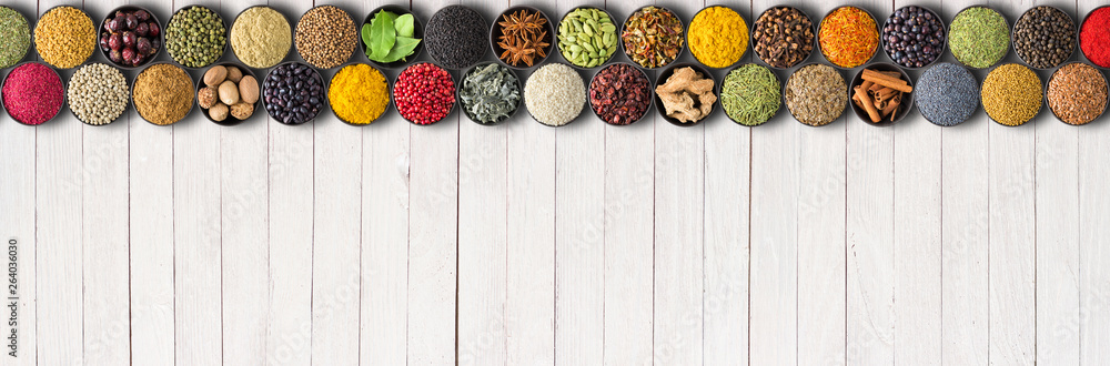 Fototapety, obrazy: Seasonings and herbs for delicious food. Spices on white table background with empty space