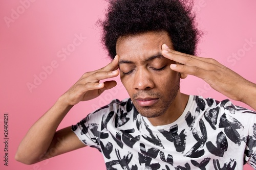 Curly African man trying to remember holding his head closed his eyes Canvas Print