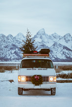 Van And Christmas Tree At Blue Hour In Front Of The Tetons