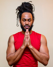 A Handsome Man With Long Hair Stands In Yoga Prayer Pose