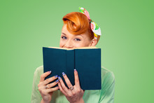 Happy Pinup Girl Hiding Herself Behind A Book