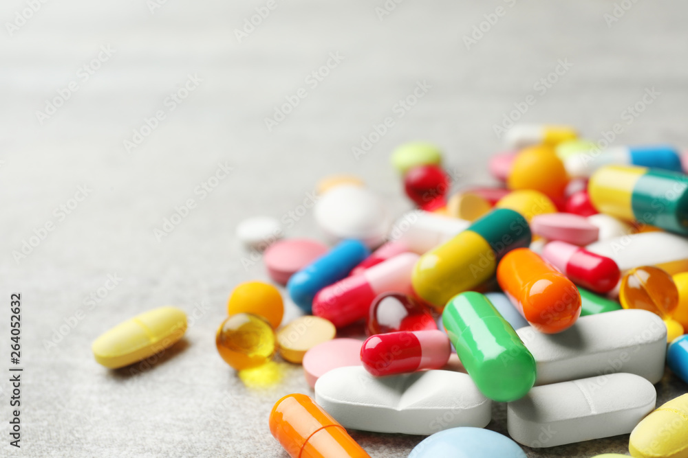 Fototapety, obrazy: Heap of different pills on table, closeup. Space for text