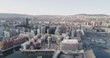 4K aerial with pan motion of the construction sites and cranes building the new and modern Oslo skyline in Bjørvika and the iconic line of buildings named Barcode in a spring sunset.