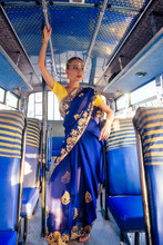 Portrait Indian Beautiful Caucasian Woman In Traditional Blue Dress.hindu Model With Golden Kundan Jewelry Set Bindi Earrings And Nose Ring Piercing Nath Fashion Photoshoot In Bus