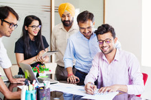 Indian Business Team Discussing A Project