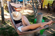 Woman Relaxing In A Hammock On...