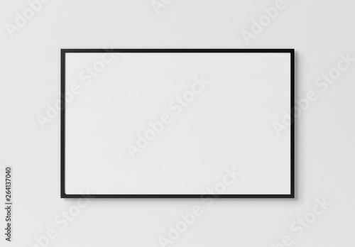 Black rectangular horizontal frame hanging on a white wall mockup 3D rendering Canvas-taulu
