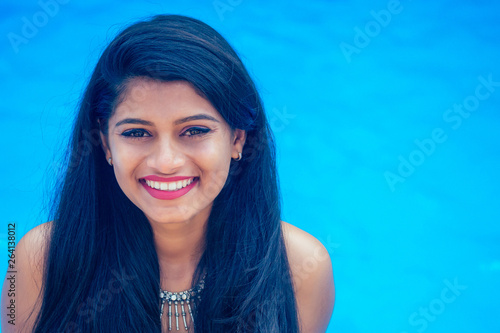 beautiful indian woman toothy white smile selfie portrait on smartphone camera s Canvas Print