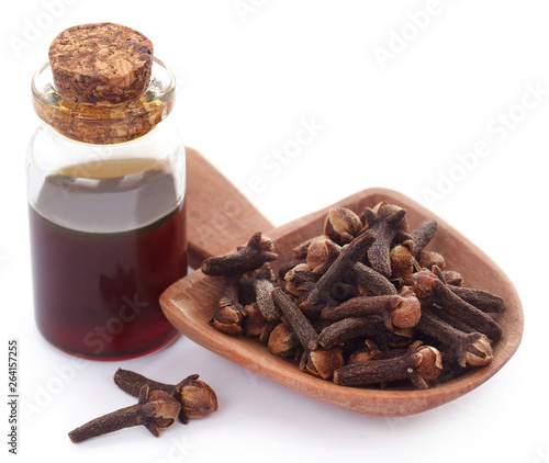 Fresh clove with oil in a jar