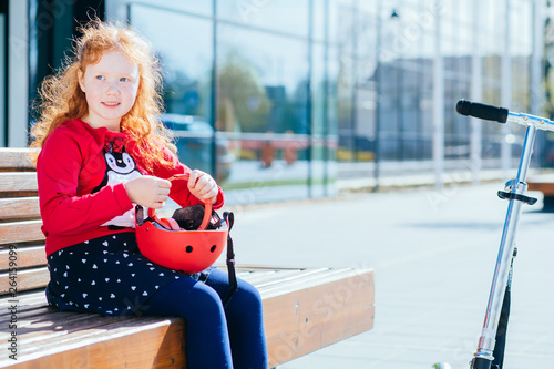 f48ecfd1e Portrait of cute adorable smiling little curly red-haired caucasian ...