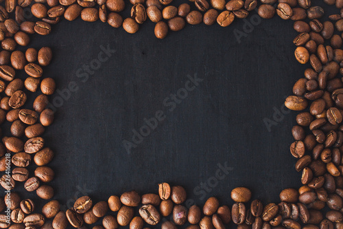 Coffee beans in a black wooden background.