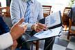 Business people analyzing marketing plan
