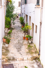 Fototapeta na wymiar Italy, Ostuni, a typical street in the ancient historic center