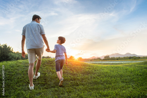 Father and son on meadow - 264197289