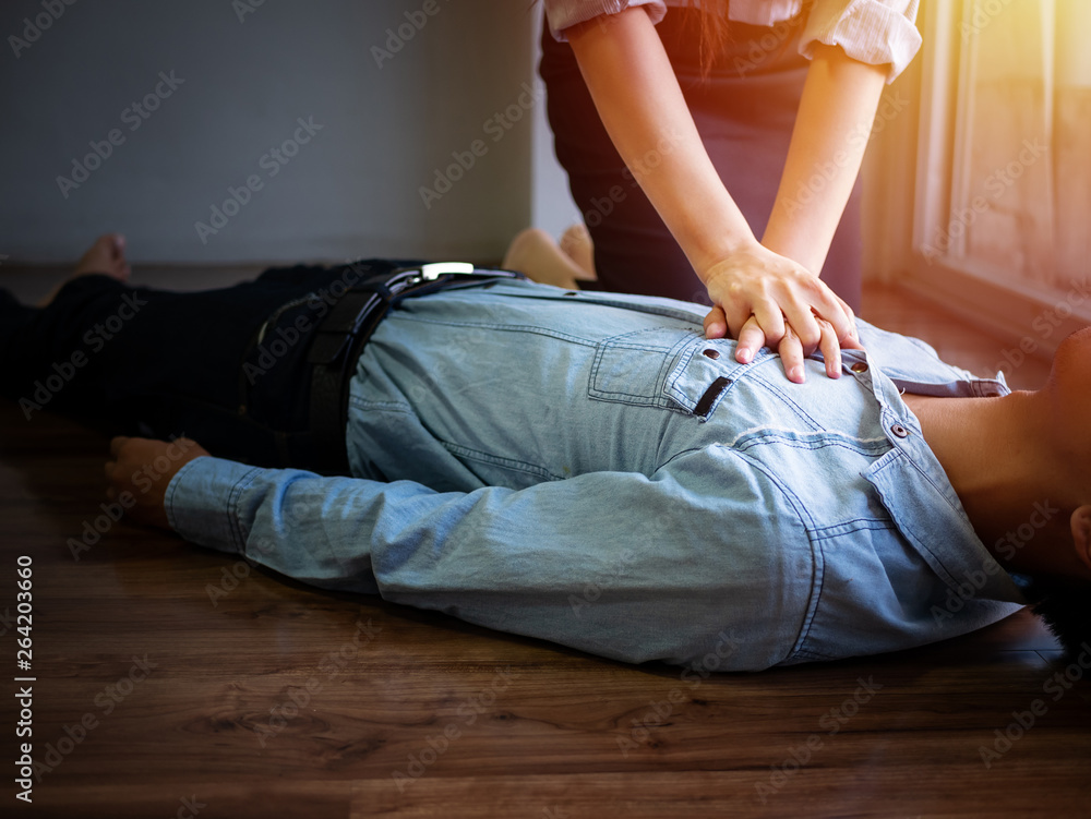 Fototapety, obrazy: volunteer office woman use hand pump on chest for first aid emergency CPR on heart attack man unconscious, try to resuscitation patient man at work