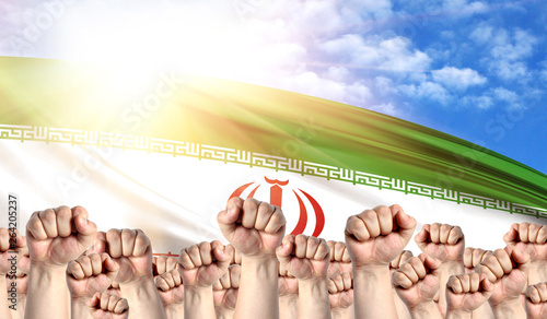 Photo  Labor Day concept with fists of men against the background of the flag of Iran