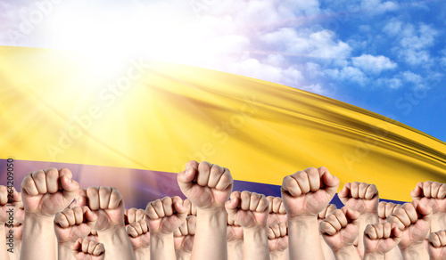 Labor Day concept with fists of men against the background of the flag of Colomb Canvas Print
