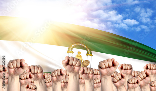 Stampa su Tela Labor Day concept with fists of men against the background of the flag of Andalu