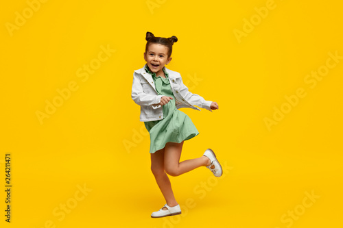 Stylish child smiling and dancing - 264211471