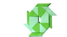 Transforming Ninja Star Origami On White Background. Ninja Star Transformer Isolated On White Background. Complex Handmade Paper Figure.