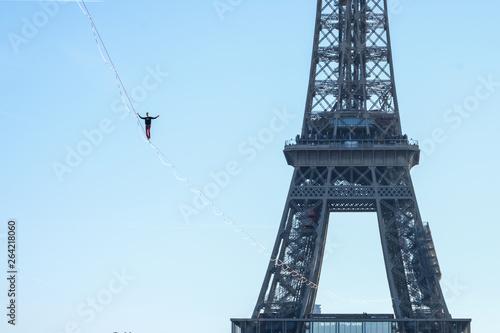 Poster Tour Eiffel a man walk on a highline between Eiffel tower and Trocadero, Île de France, Paris, France