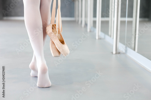 Ballerina takes off ballet pointe shoes Wallpaper Mural