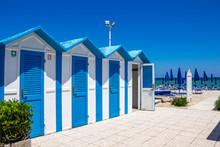 Beautiful Old Blue And White Painted Beach Huts At Porto Recanati, Province Of Macerata, Marche, Italy