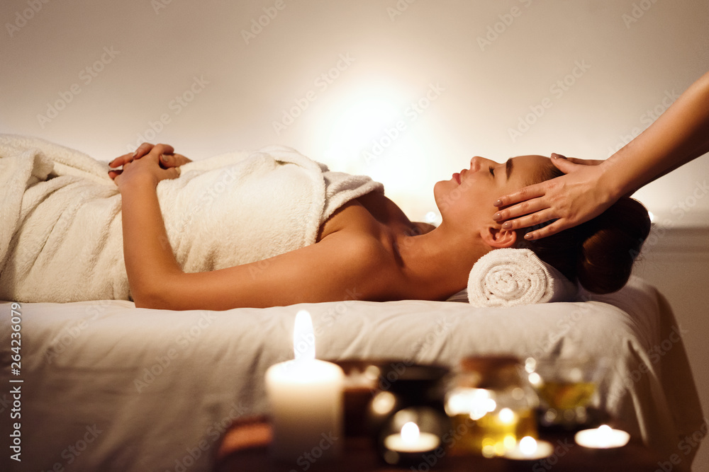 Fototapety, obrazy: Young girl having face massage, relaxing in spa salon