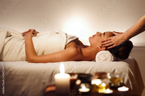 Spoed Foto op Canvas Ontspanning Young girl having face massage, relaxing in spa salon