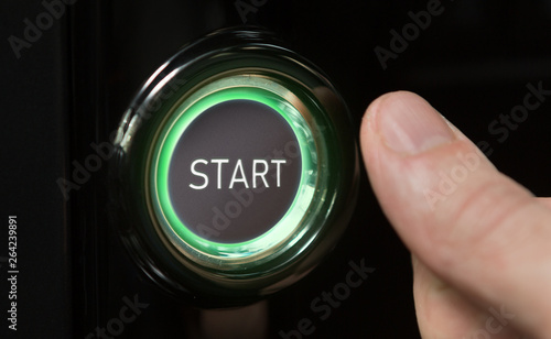 Man pushing green lighted button with word Start Canvas Print