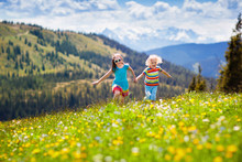 Children Hiking In Alps Mounta...