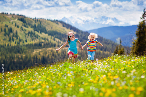 Fotografie, Obraz Children hiking in Alps mountains. Kids outdoor.