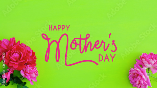 Happy Mother's Day text, bright green background with pink roses. - 264249630