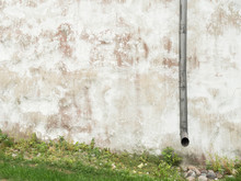 An Old Wall And Downspout