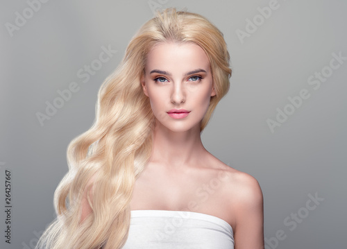 Tela Beautiful hair woman blonde long hairstyle beauty healthy skin face closeup