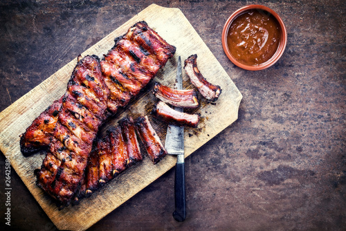 Barbecue spare ribs St Louis cut with hot honey chili marinade as top view on a Canvas Print